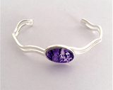 Pretty purple wave bangle fully adjustable to fit the owner hand painted in wax and sealed in glass