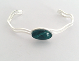 Fully adjustable jade wave bangle hand painted in wax and sealed in glass