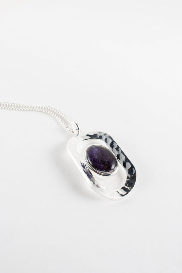 The midnight purple cabochon of this silver plated hammered pendant gives it a mysterious feeling and elegant look, handpainted in bees wax and sealed in resin and glass, stunning, beautiful