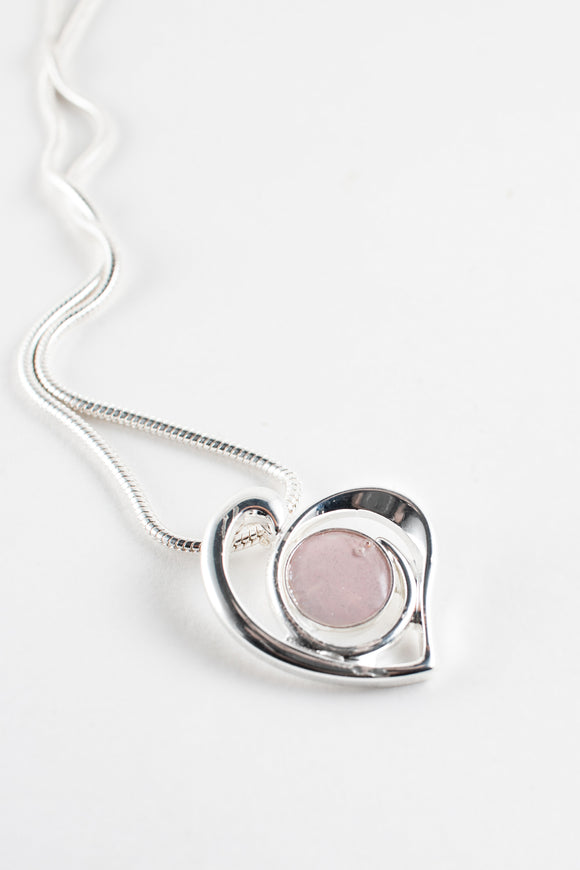 Sterling silver heart pendant. Shimmer cabochon, pearly pink