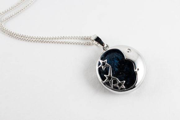 This mysterious midnight blue, moon and star cage pendant, stunning, beautiful, unique