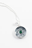 May birthstone emerald paired on a strikingly silver background to make the stone stand out hand painted in bees wax and sealed in glass