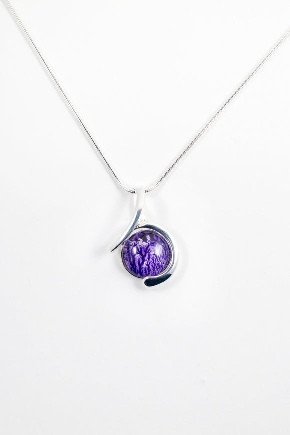Circular swirl pendant purple handpainted in wax and sealed in glass