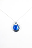 Blue double teardrop pendant handpainted in wax and sealed in glass stylish and beautiful
