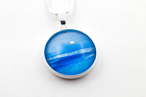 Sterling silver blue moon scape pendant stunningly hand painted in bees wax and sealed in glass