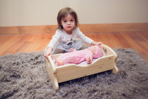 Little Girl with Little Colorado Doll Cradle