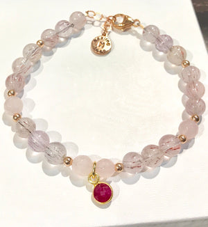 Super Seven Gemstone Bracelet with Ruby Charm and Rose Quartz