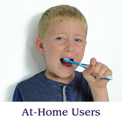 A boy brushes his teeth with a Surround Toothbrush | Specialized Care Co