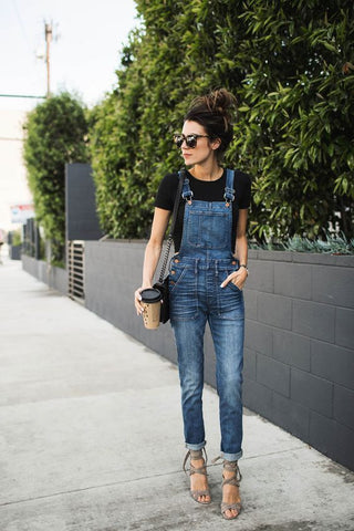 black tee and overalls