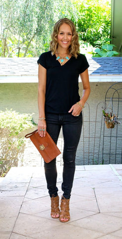 black tee and statement necklace