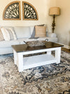 Chunky farmhouse coffee table, clean lines, distressed