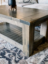 Chunky farmhouse coffee table, clean lines, aged barrel