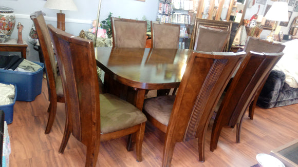 Gently used Ashley Furniture Dining Table with 8 Chairs