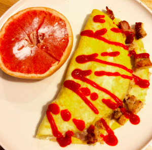 Breakfast: Omelet stuffed with turkey and veggies and topped with cheese; side of grapefruit sprinkled with Stevia.