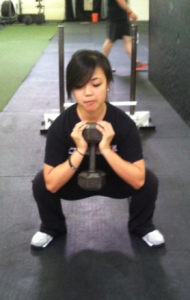 Hangin' out at the bottom of a dumbbell goblet squat. I could do this all day.