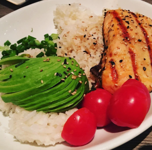 Salmon, avocado, and tomatoes over rice