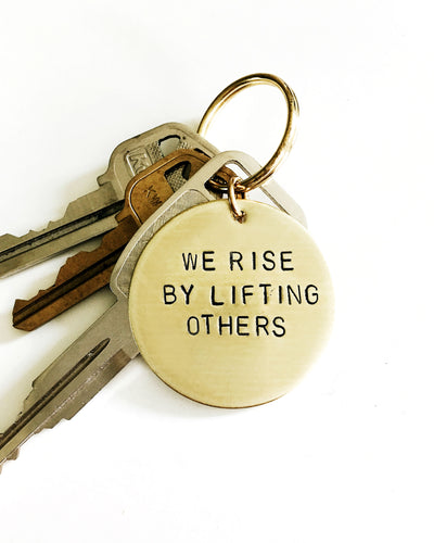 We Rise By Lifting Others Handstamped Keychain