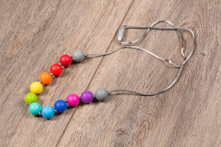 Itzy Ritzy - Rainbow Teething Necklace