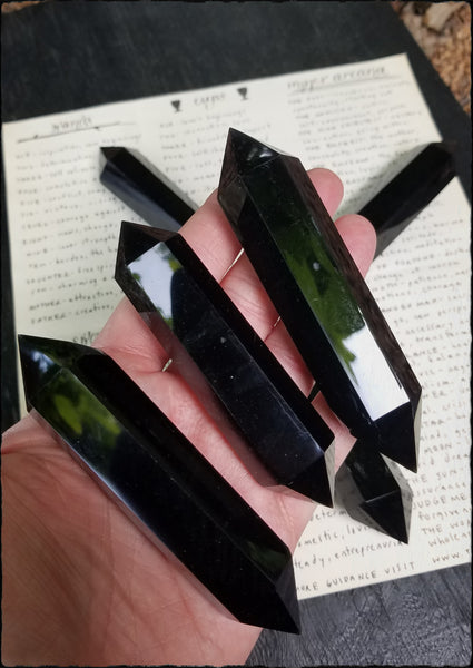 Double terminated obsidian points~