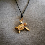 Brass Turtle Necklace worn by model