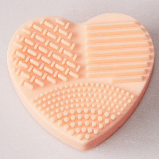 Makeup brush scrubber