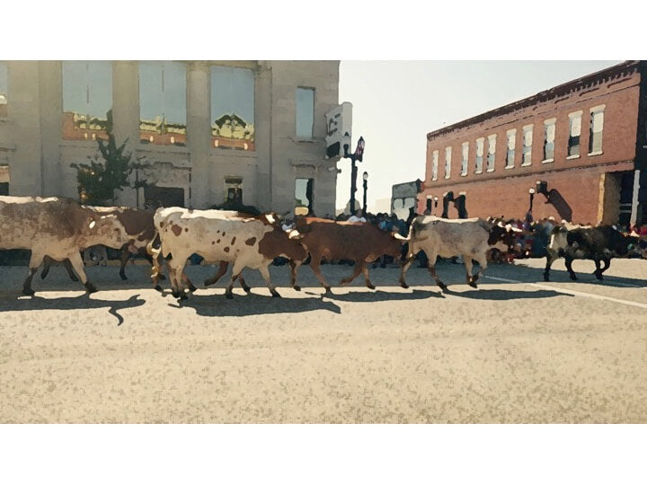 Watercolor of the longhorn cattle drive through the country town in the heartland of America