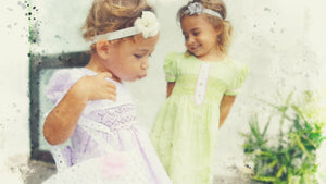 The Open Road ethical children's and little girls dresses watercolor image of two little girls in Fiji in purple hand-smocked dress and a girl behind green smocked dress