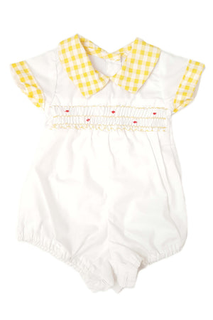 Front of baby boy's white romper with shirt collar in contrasting yellow and delicate hand-smocked bodice