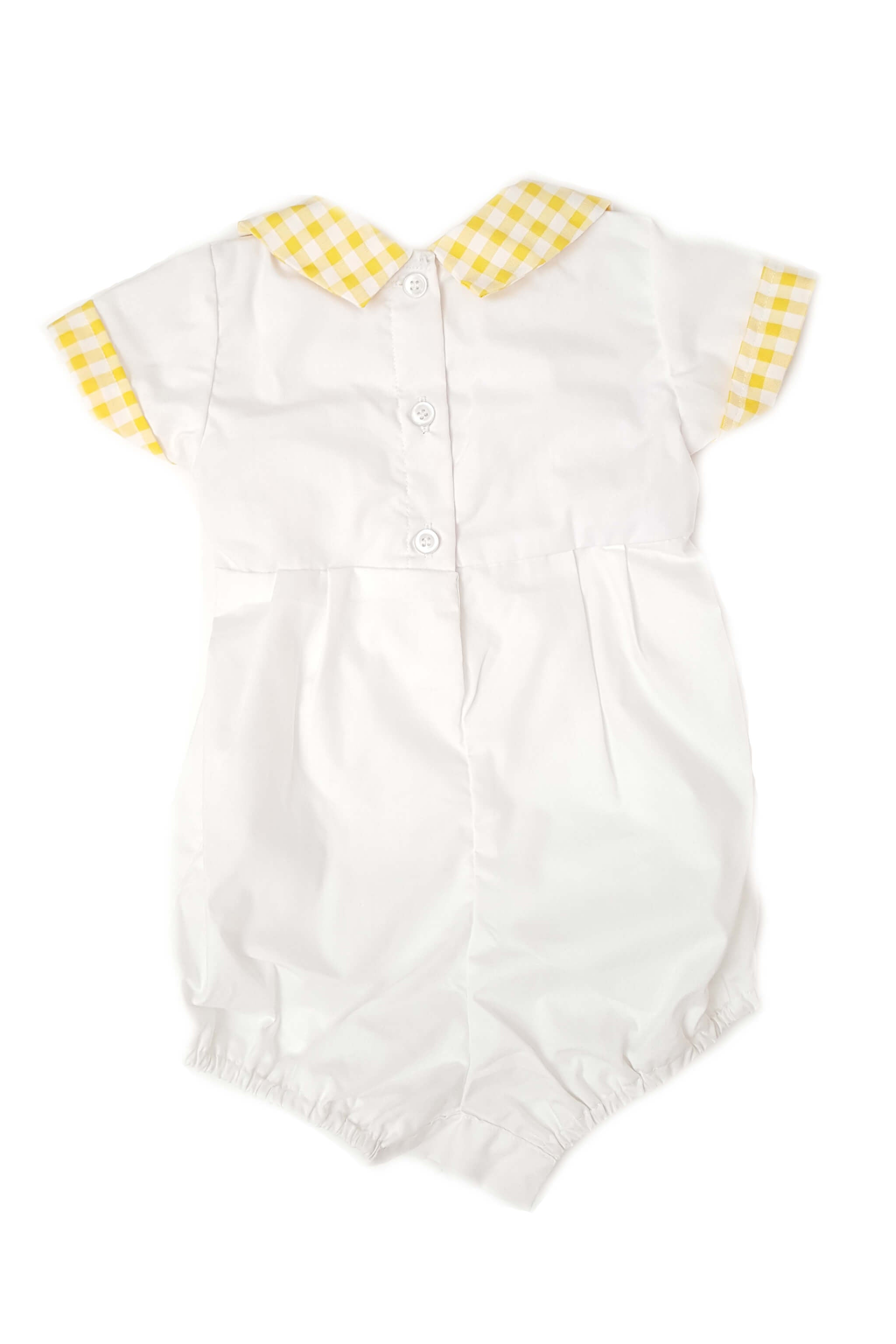 Back of baby boy's white romper with shirt collar in contrasting yellow and delicate hand-smocked bodice and button back opening