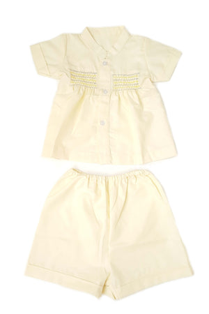 Pale yellow shirt and shorts set for baby boys with Nehru collar and hand-smocked bodice
