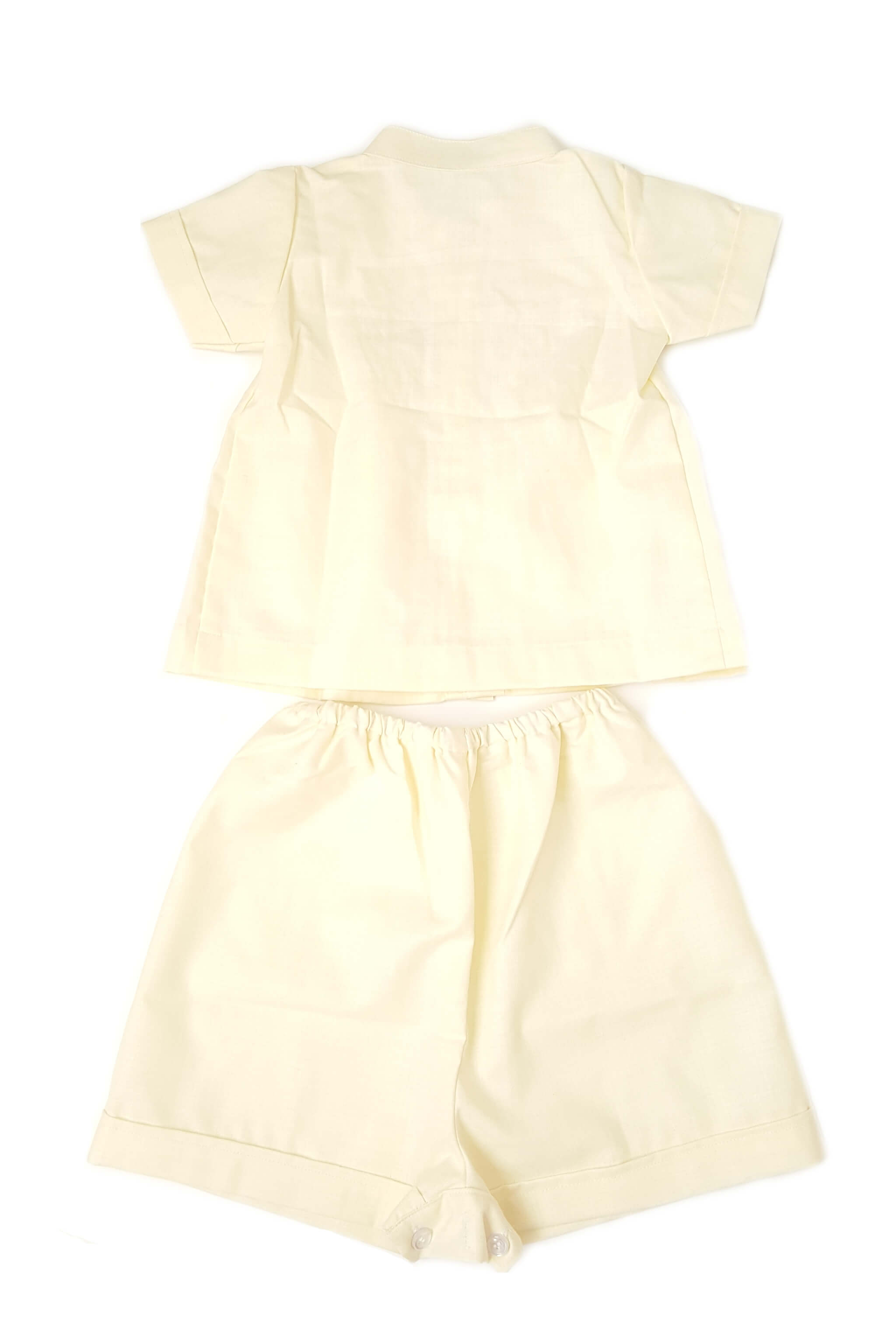 Back of Pale yellow shirt and shorts set for baby boys with Nehru collar and hand-smocked bodice and button front opening, elastic waist with bottom button opening for shorts