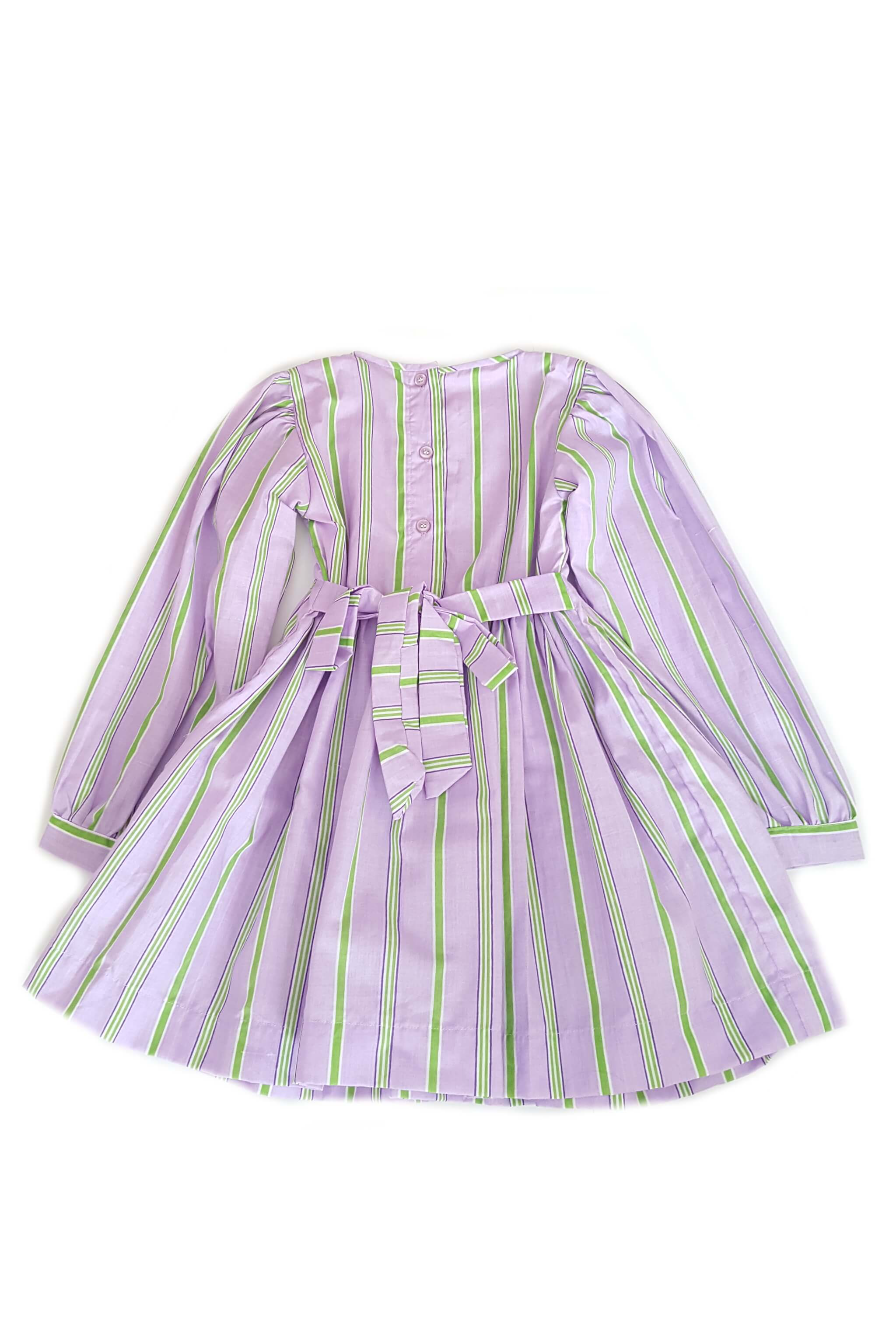 Back of whimsical long sleeve Amber dress in striped lavender and apple shades with button back and sash to tie at waist for girls