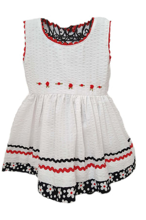 White seersucker dress with red hand-embroidered flowers at the waist for baby girls