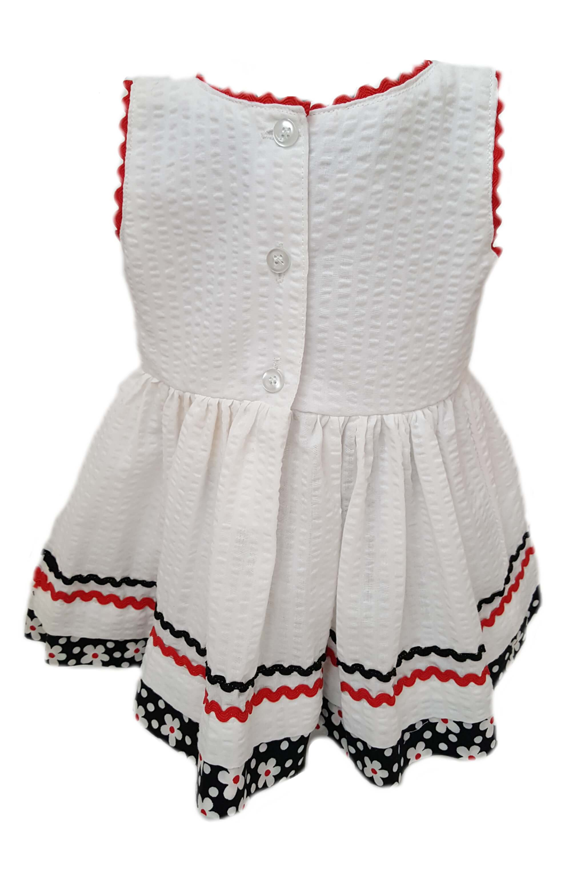 Back of white seersucker dress with red trim and button back for little girls