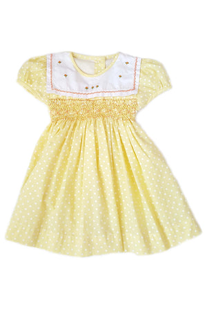 Yellow pin dot dress with hand-smocked bodice and white square collar with hand-embroidered orange rosettes for baby girls
