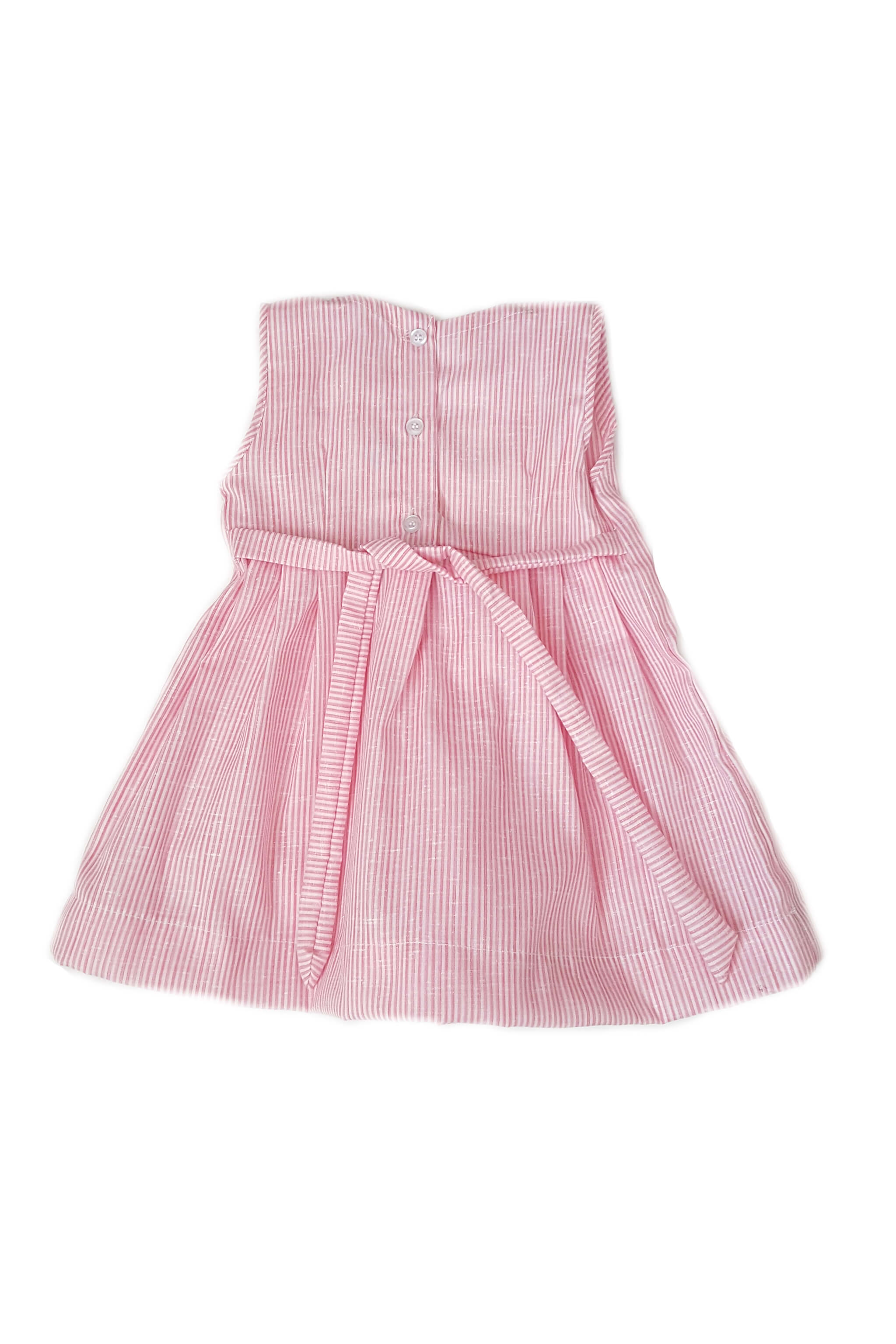 Back of pink-striped dress with square neckline and white bodice with smocking with button back and sash to tie at waist for baby girls