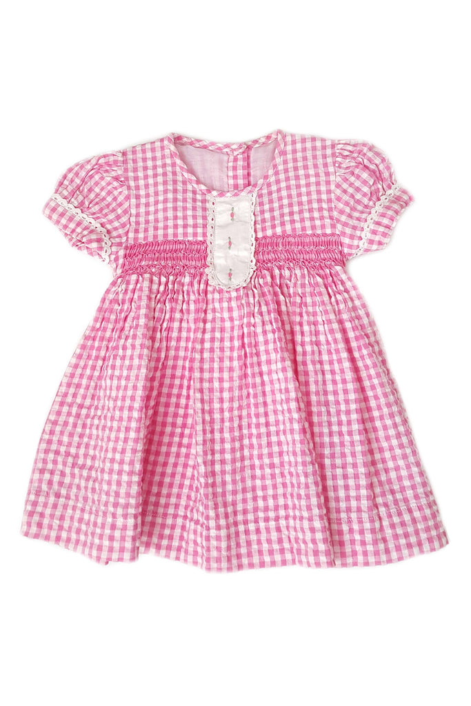 Pink seersucker dress with contrasting white placket featuring hand-embroidery and a hand-smocked bodice for baby girls