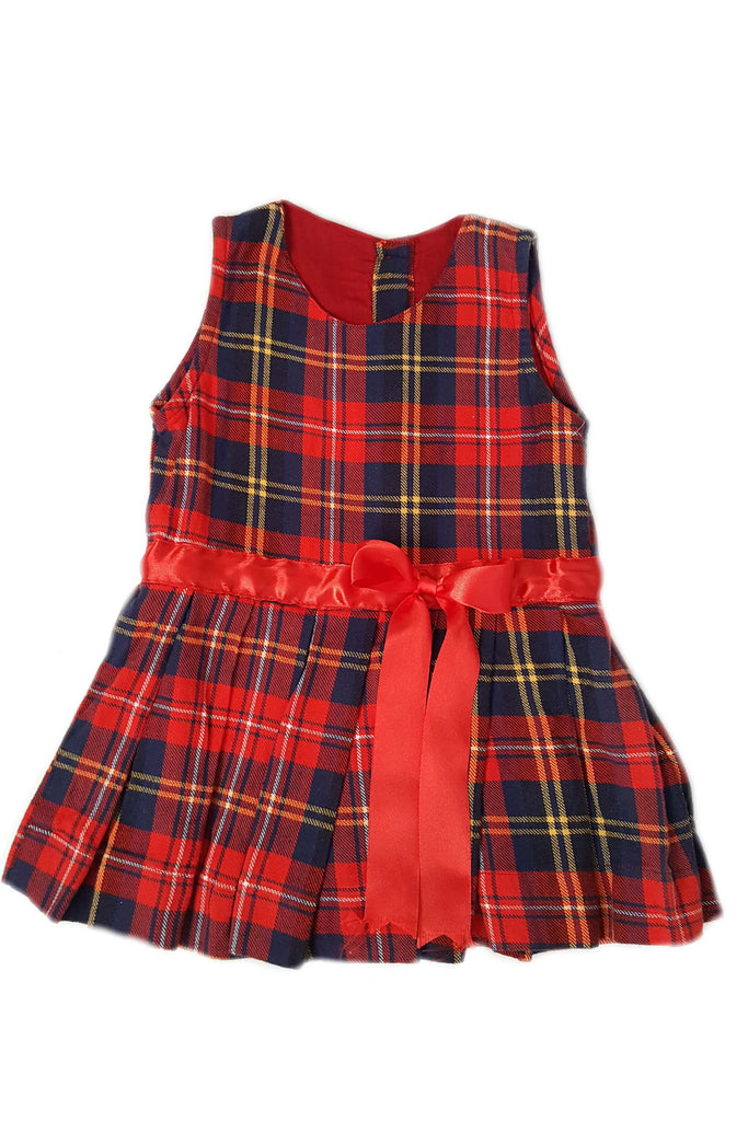 Front of vintage style plaid baby girl's sleeveless dress with box pleats and red satin bow at waist