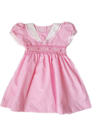 Pink gingham dress with white sailor collar, pink satin trim and hand-smocked bodice for little girls