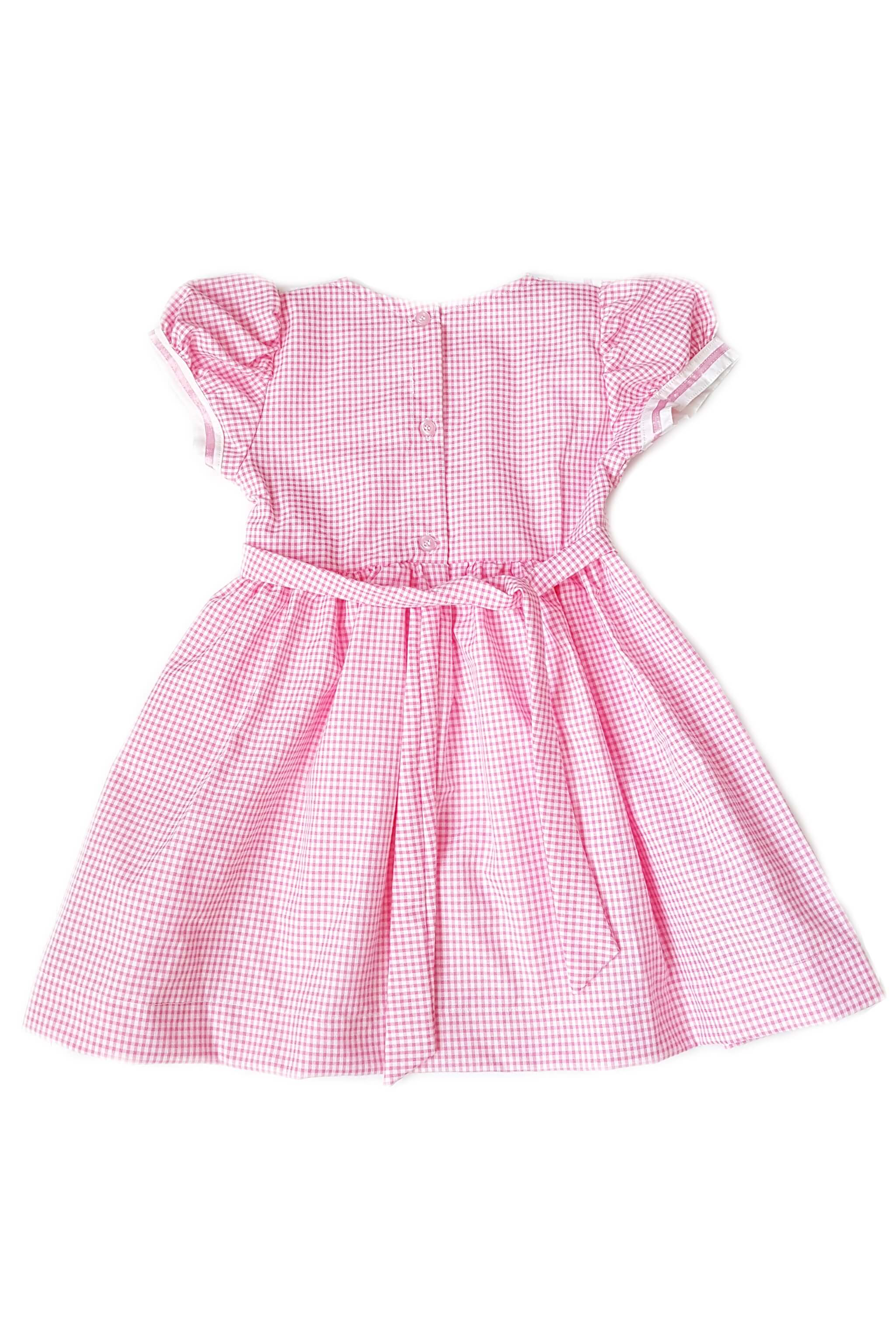 Back of pink gingham dress with white sailor collar, pink satin trim and hand-smocked bodice with button back and sash for little girls