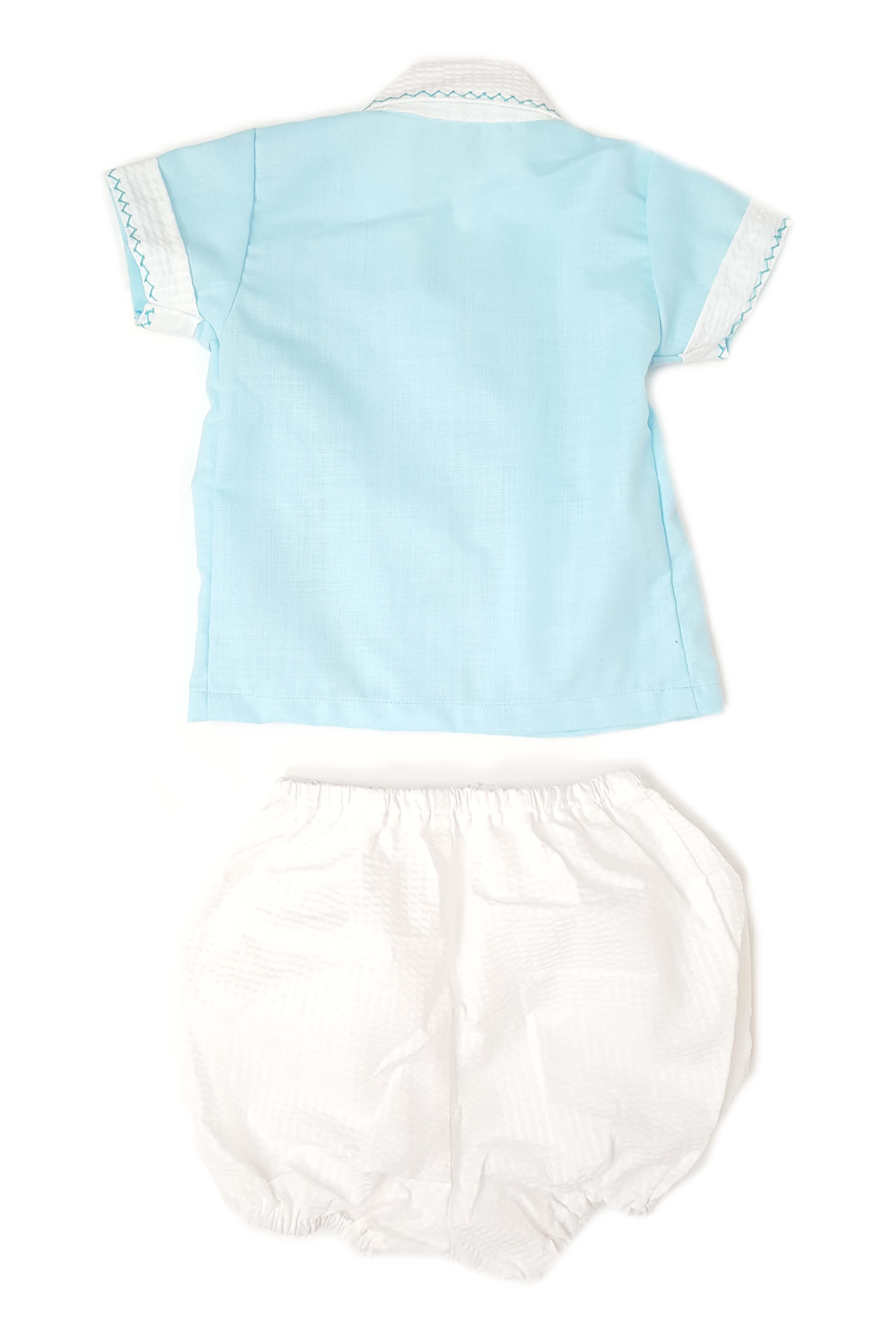 Back of blue shirt with delicate hand-smocked bodice and contrasting white collar and cuffs with white bloomer for baby boys