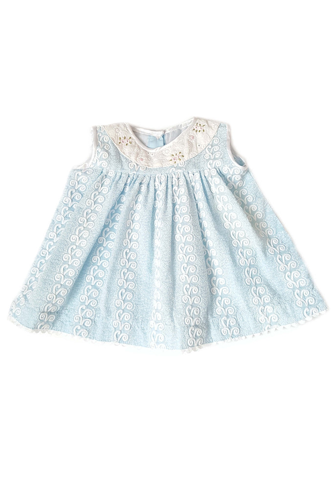 Dainty baby blue frock with delicate white embroidery, blush pink hand-embroidered flowers and eyelet trim for baby girls