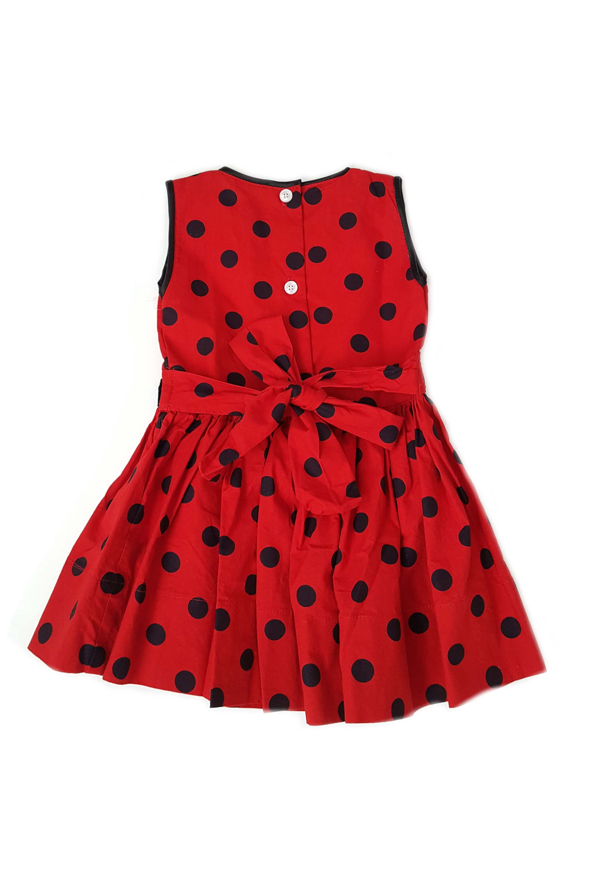 Back of Gwen dress from The Open Road with black and red polka dot print and button back with sash