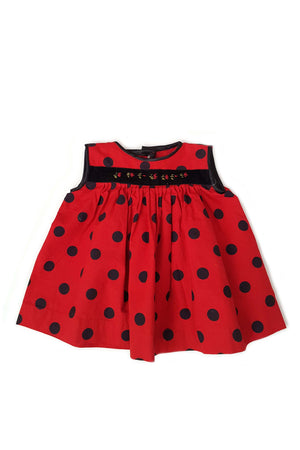 Front of Gwen dress from The Open Road with black and red polka dot print and black velvet trim