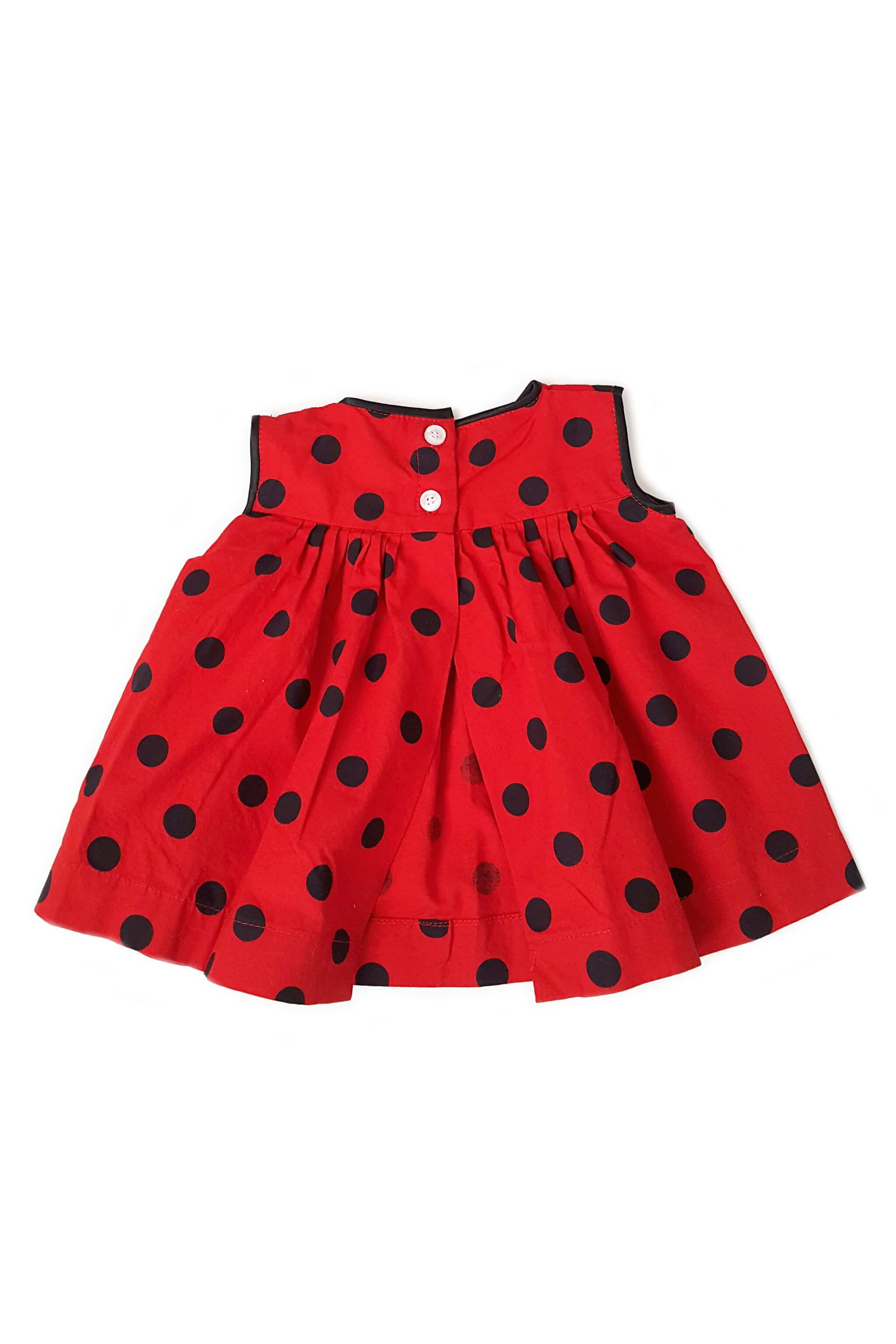 Back of Gwen dress from The Open Road with black and red polka dot print and button back opening