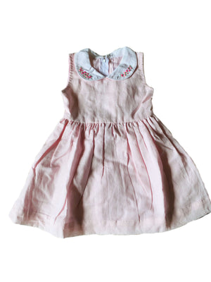 Blush pink sleeveless linen dress with contrasting white peter pan collar featuring elegant hand-embroidered pink rosettes and gathered waist for girls