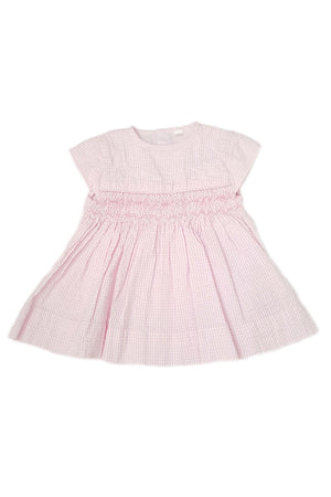 Classic pale pink seersucker dress with cap sleeves and hand-smocked bodice for baby girls