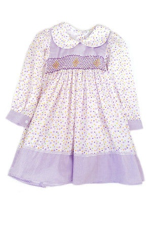 Front of pale purple floral print peter pan collar Keira dress with contrasting chest and hem with long sleeves and hand-smocked bodice for girls
