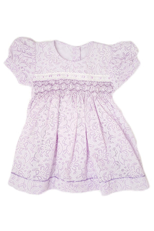 Lavender floral print dress with hand-smocked bodice and soft purple satin trim for baby girls