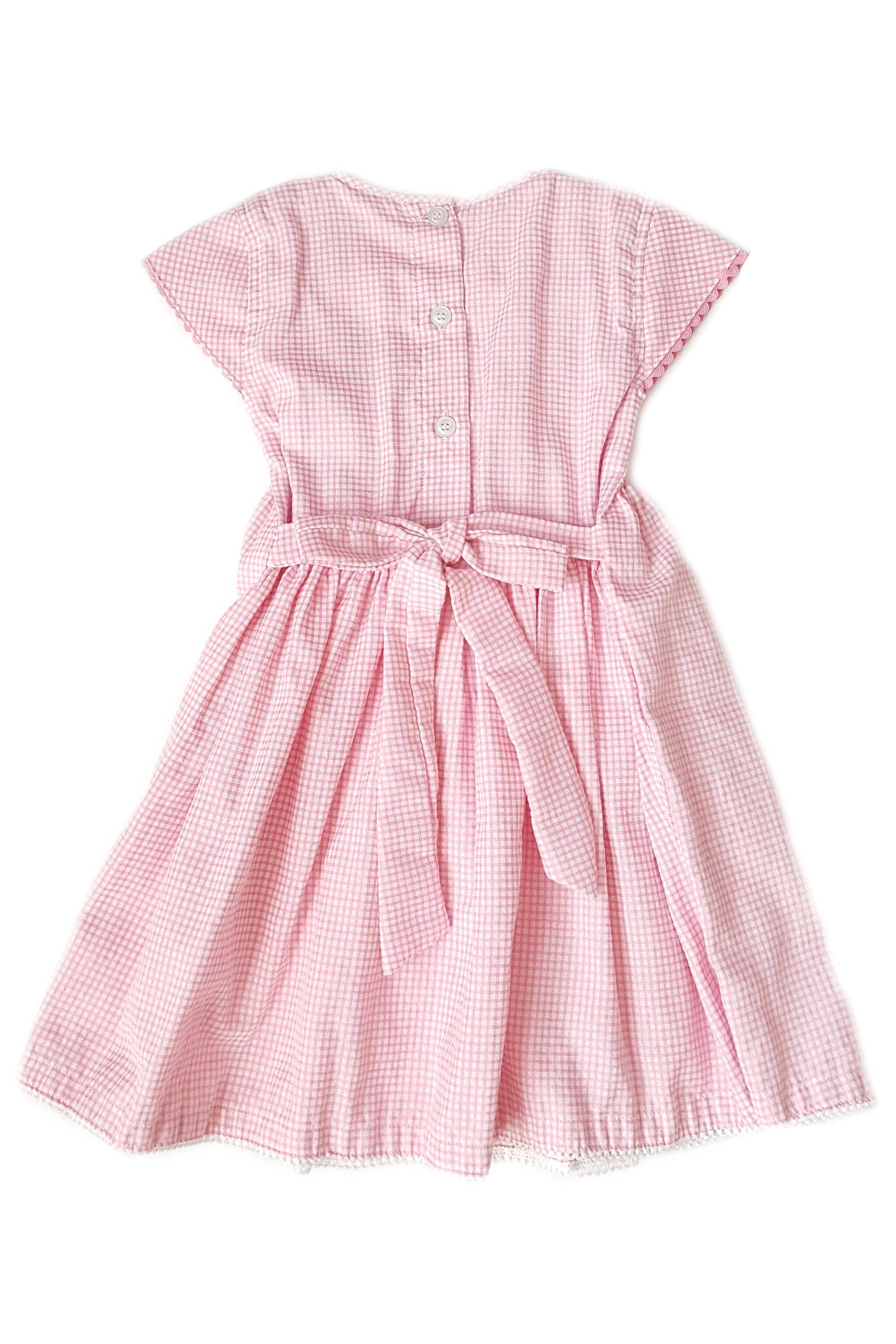 Back of pink gingham dress with hand-smocked bodice and white collar with hand-embroidered rosettes and sash to tie at waist for girls